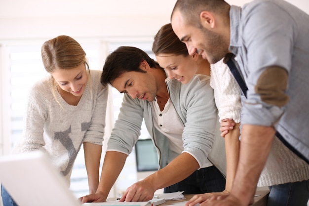 Group of business people in office working on project