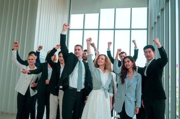 A group of business people raised their hands up