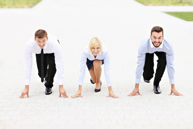 A group of business people ready to compete in a race