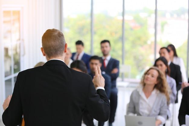 Group of business people in seminar or meeting