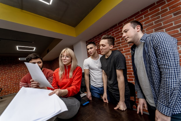 Group of business people and software developers working as a team in office.