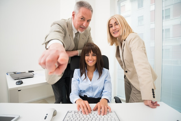 Group of business people using a computer