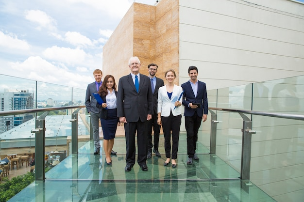 Group of business people walking on a glass walkway