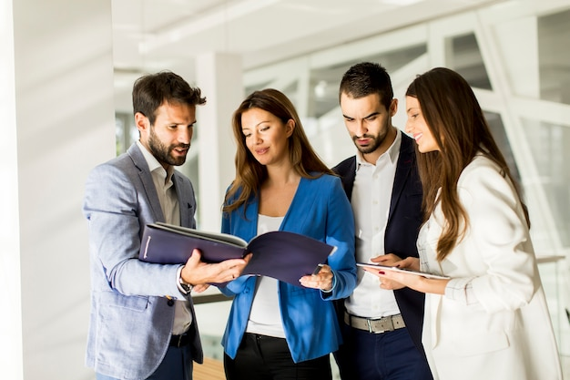 Group of business people who standing and discuss