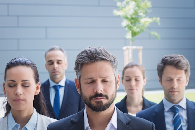 Group of business people with eyes closed