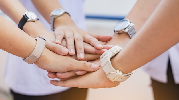 Group of businessman hands together joining for teamwork and business collaboration