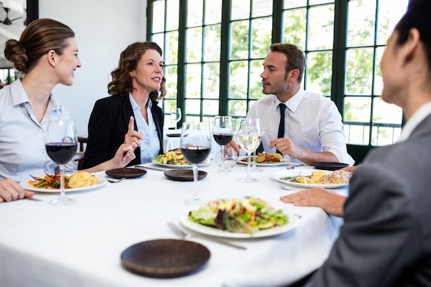 Group of businesspeople at business lunch meeting