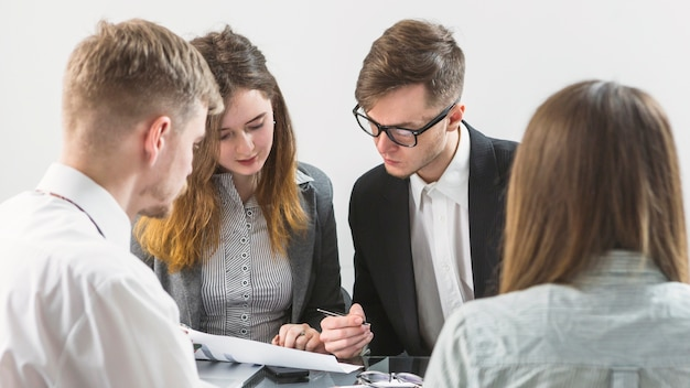 Group of businesspeople discussing document in office