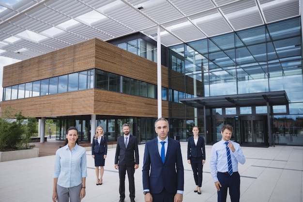 Group of businesspeople standing outside office building