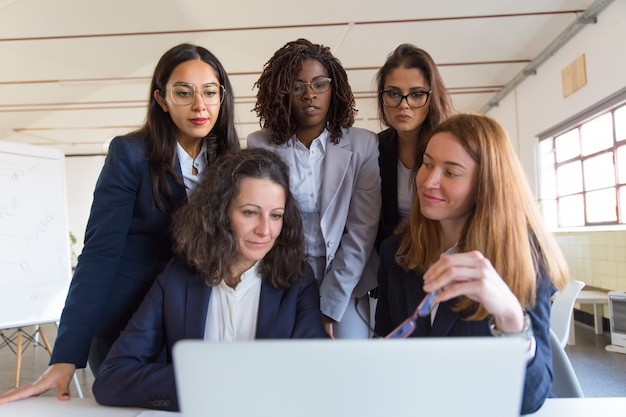 Group of businesswomen working with laptop