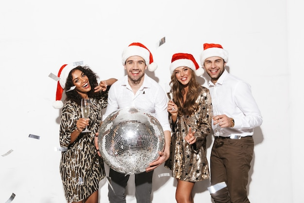 Group of cheerful smartly dressed friends celebrating new year isolated over white space