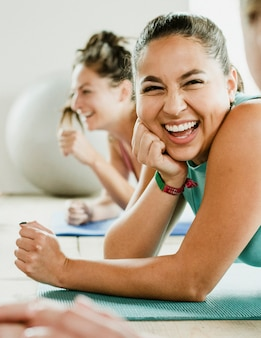 Group of cheerful women in yoga class