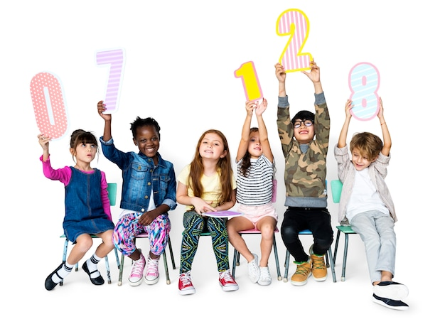 A group of children are holding a number