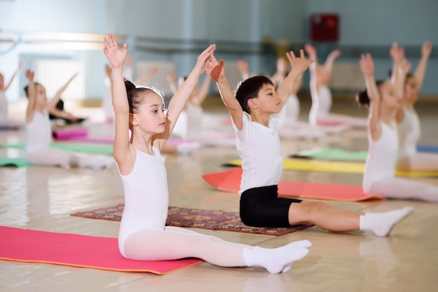 A group of children in a ballet school or in a gymnastics section on carimat