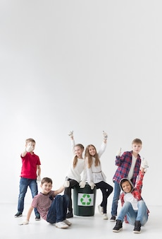 Group of children happy to recycle together