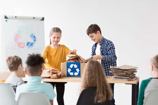 Group of children learning how to recycle