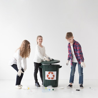 Group of children recycling together
