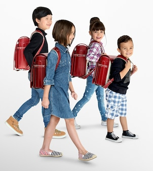 A group of children with a backpack