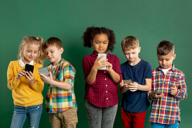 Group of childrens using phones