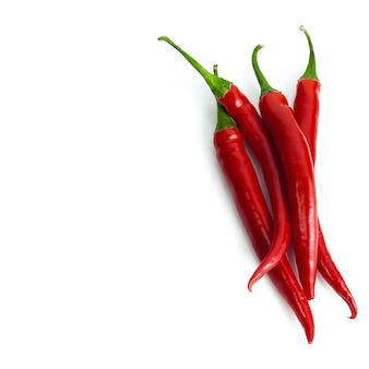 Group of chili peppers isolated over white and place for text