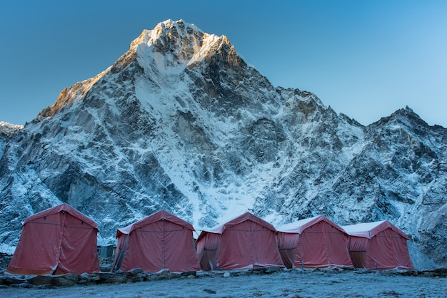 Group of climbers bright tents on the khumbu glacier of everest base camp with colorful pr