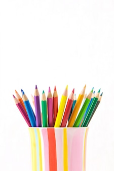 Group of color pencils in a colorful cup