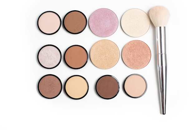Group of colorful contour and highlight refills with a brush over a white background