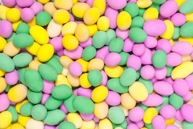Group of colorful peanuts in glaze. top view.