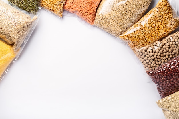 Group of colorful various cereals and legumes in plastic wrap. protein products.