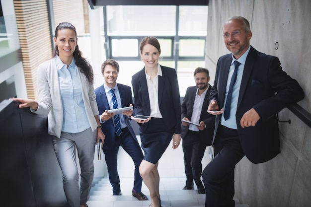 Group of confident businesspeople in office