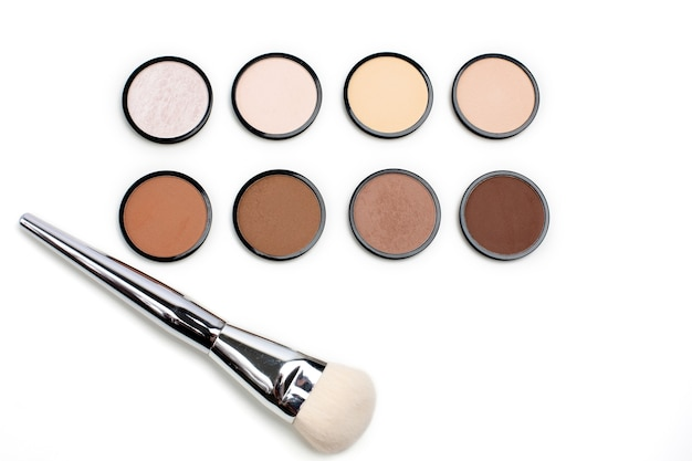Group of contour and highlight refills with a brush over a white background