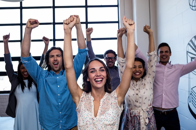 Group of coworkers hands up