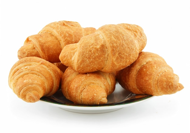 Group of croissants on saucer isolated on white background