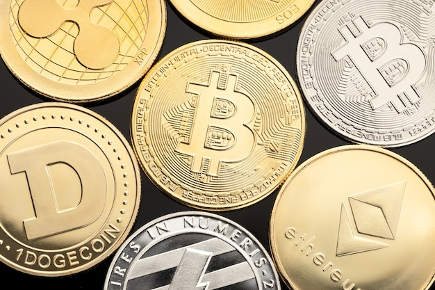 Group of cryptocurrency coin on black background top view