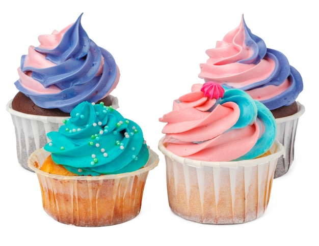 Group of cupcakes with colored topping isolated on white background