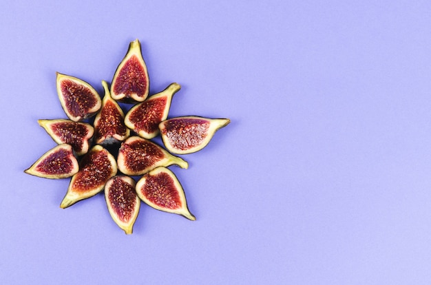 Group of cut figs on a blue background copy space. flat lay.
