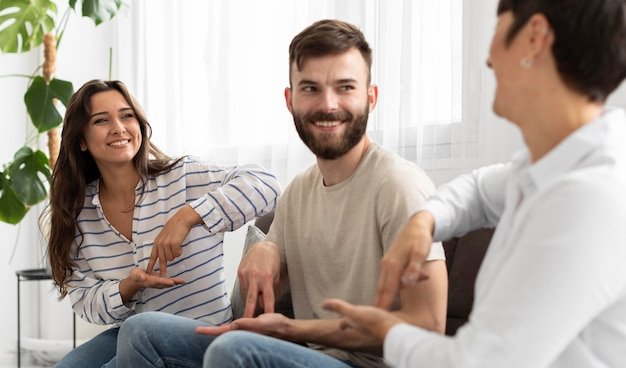 Group of deaf people communicating through sign language