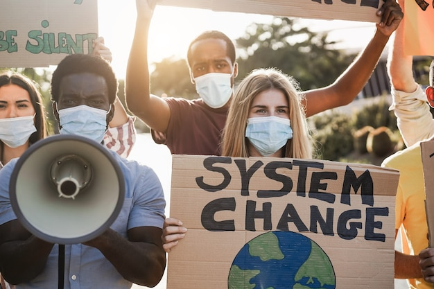 Group of demonstrators on road from different culture and race protest for climate change during coronavirus outbreak - focus on right girl face