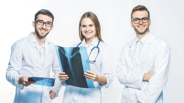 Group of diagnosticians with xrays on a white background