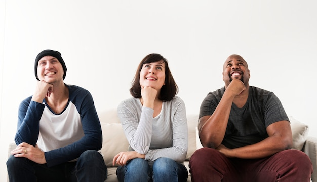 Group of diverse friends sitting on couch