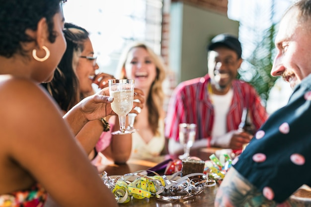 A group of diverse friends toasting at a party