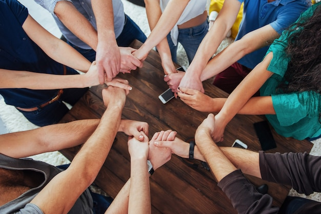 Group of diverse hands together joining.   teamwork and friendship
