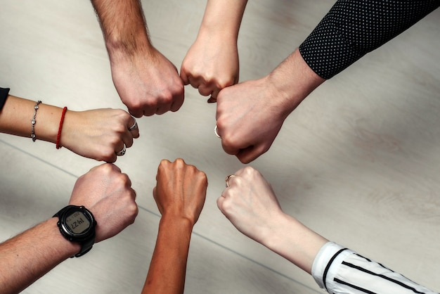 Group of diverse multiethnic people putting hands together