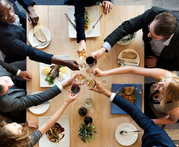 Group of diverse people are having lunch together