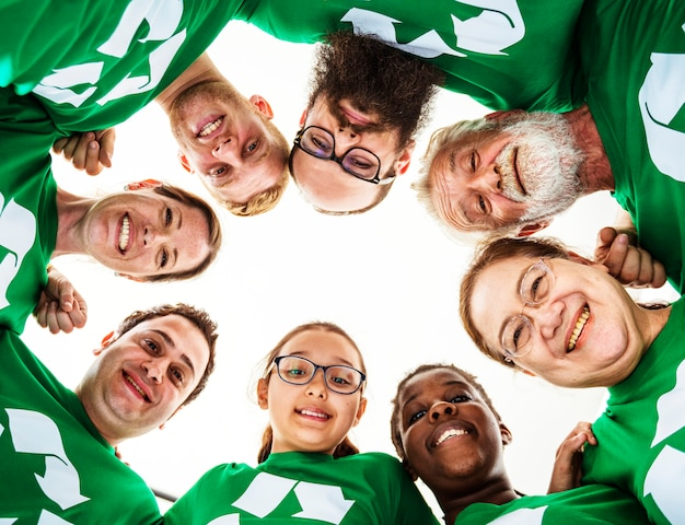 Group of diverse people in green recycle tee