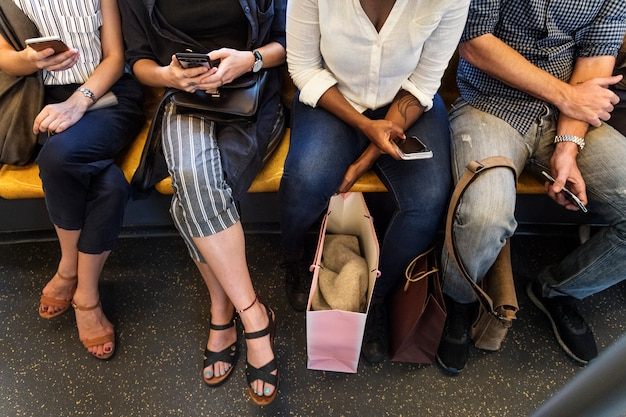 Group of diverse people riding a train