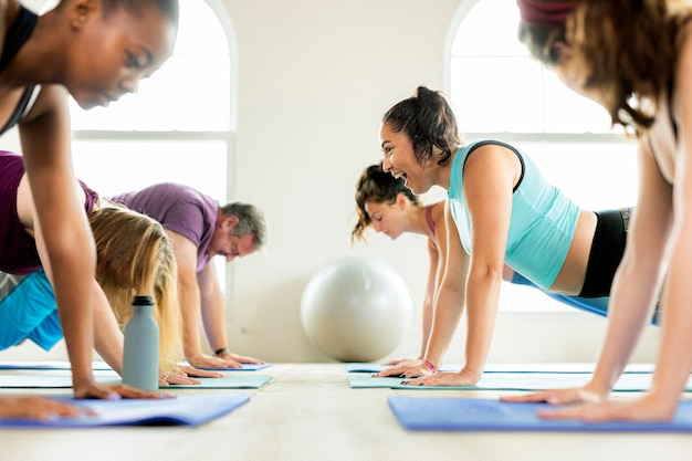 Group of diverse people in yoga class Premium Photo