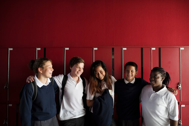 Group of diverse students standing by the locker