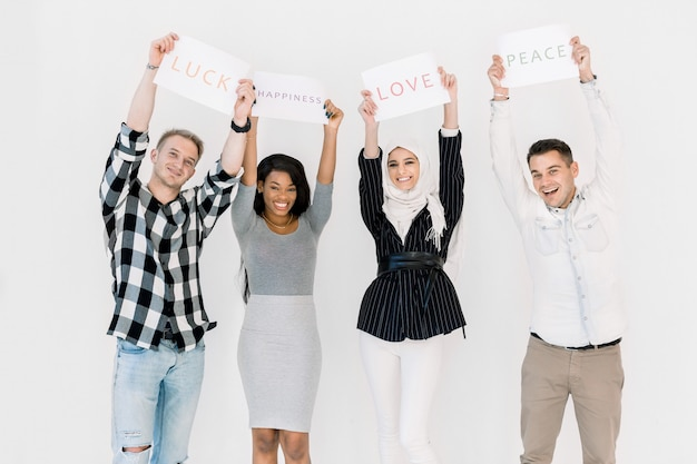 Group of diverse women and men standing together against white background