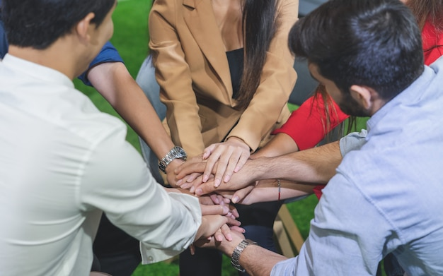 Group of diverse young have life problem joining hands make strengthen in mind during therapy session